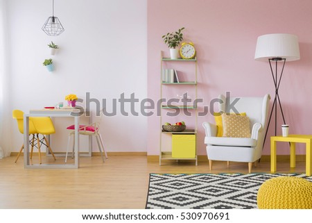 Shutterstock Pink living room with white and yellow furniture