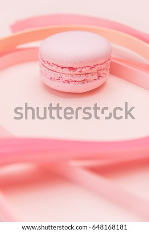 Pink Macaron and paper strips on a light background #648168181