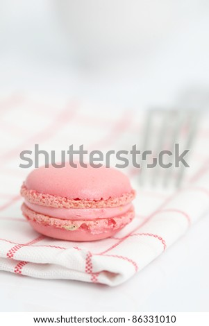 Pink Macaron in close up isolated on white background