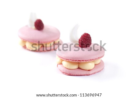pink macaron with raspberry on top