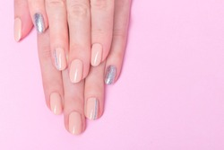 Pink manicure design with silver line . Beautiful nails
