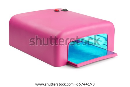 Pink manicure gel curing lamp isolated on white