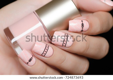 pink manicure with tropical leaves and a geometric pattern #724873693