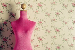 Pink mannequin with flowers background