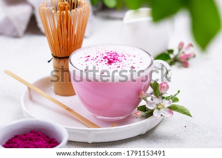 Pink matcha latte with milk. Trendy drink from dragon fruit powder Stock photo ©