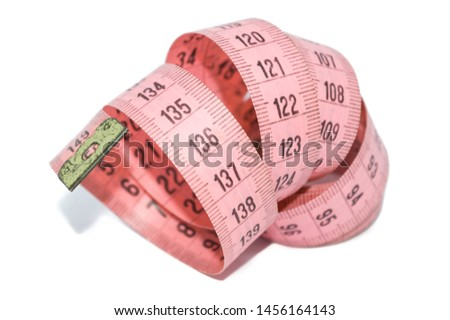 pink measuring tape, to control body measurements or use of seamstresses, isolated on white background