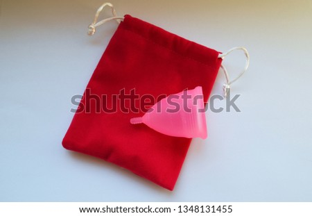 pink menstrual cup on the bag #1348131455