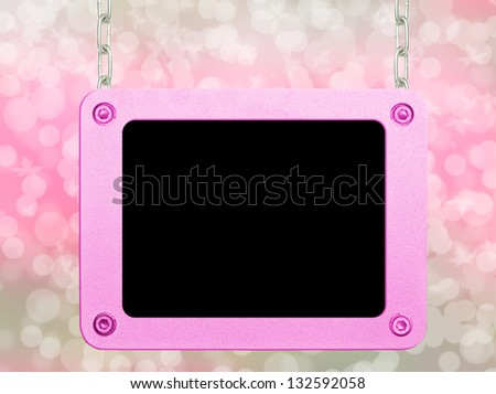 Pink metallic frame picture hanging by chains on isolated bokeh background