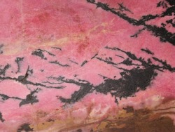 pink mineral rhodonite ( manganese inosilicate) with black manganese oxides