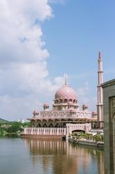 Pink mosque on lake in Putrajaya, Kuala Lumpur, Malaysia