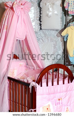 Pink nice baby bed in furniture shop