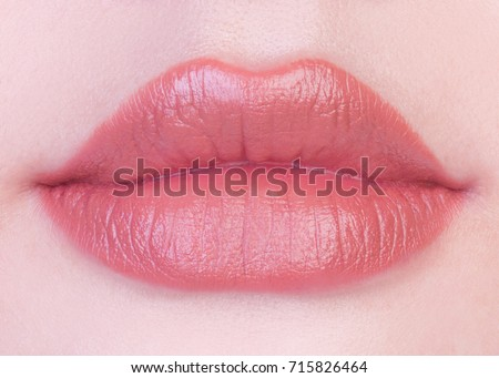 pink nude matte lipstick on lips stock photo