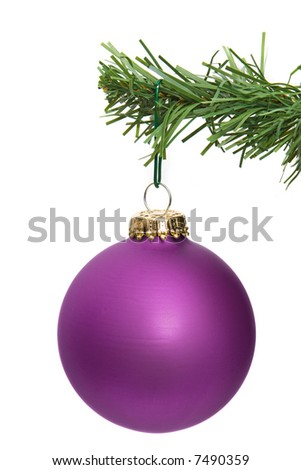 pink ornament hanging on a pine tree branch