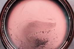 Pink paint in cans