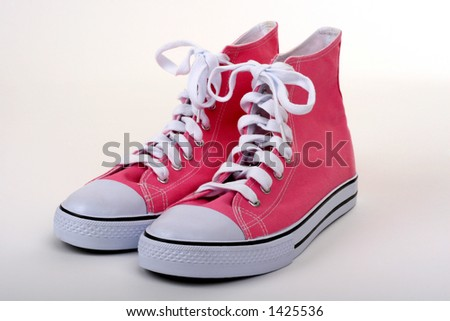 pink pair of women's high top shoes