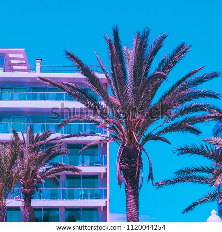pink palm trees  and hotel against the blue sky. bright neon colors. minimal and surreal. summer vacation. urban style. 80s style #1120044254