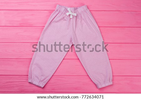 Pink pants with fine pattern. Pajama's bottom with elastic cuffs and waist. Cute garments for toddler girls. #772634071