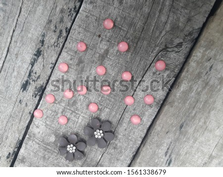 Pink pearl with gray Flowers on old rusted wood board #1561338679