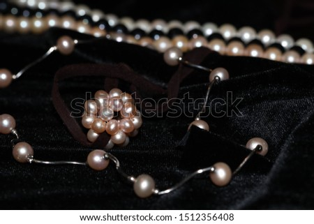 pink pearls jewelry on a black velvet background #1512356408