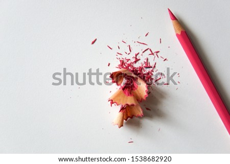 Pink pencil with pink pencil shavings