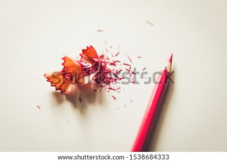 Pink pencil with pink pencil shavings on a white background #1538684333