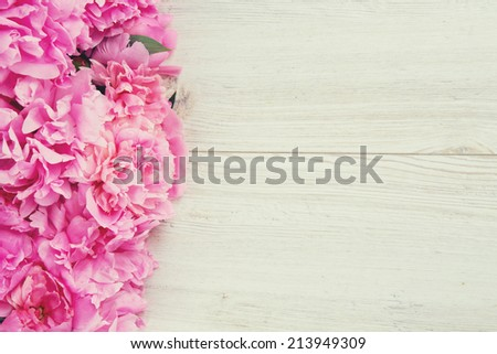 pink peonies on wooden surface