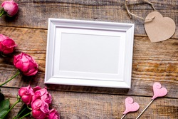 pink peony and frame for present on wooden background top view mockup