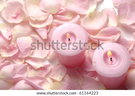 pink petals of roses and burning candles