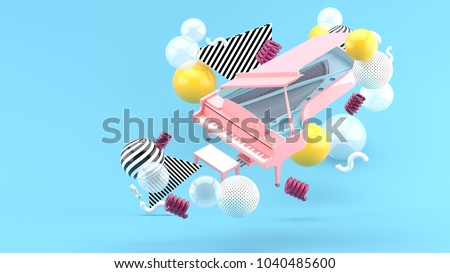 Pink piano among colorful balls on a blue background.-3d render. stock photo