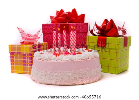 Pink pie with five candles and gifts in boxes on a white background