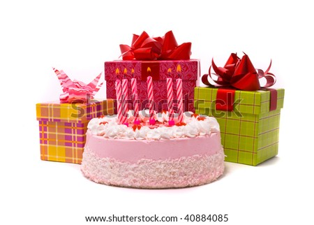 Pink pie with six candles and gifts in boxes on a white background