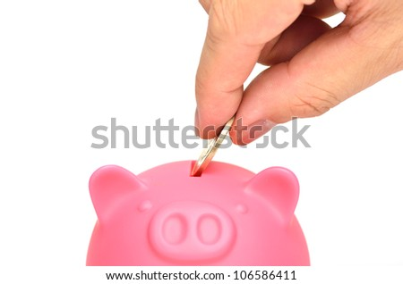 Pink piggy bank, isolated on white background.