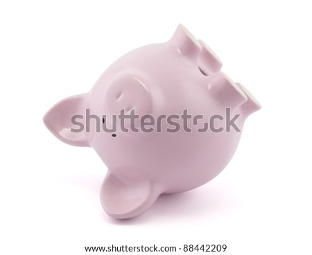 Pink piggy bank upside down. Clipping path included.