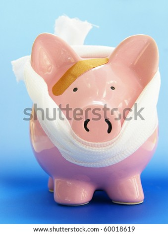 pink piggy bank with bandaid, on blue