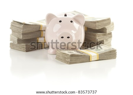 Pink Piggy Bank with Stacks of Hundreds of Dollars Isolated on a White Background.