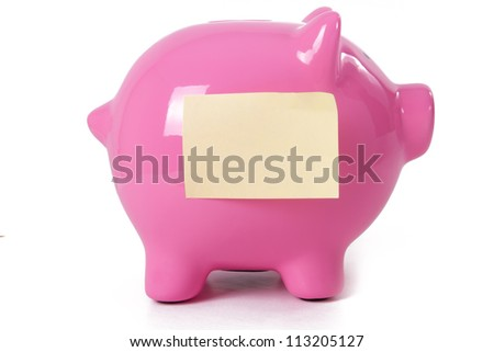 Pink piggy bank with yellow sticky note, isolated on white background.