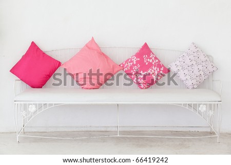 Pink pillow on the chair with white