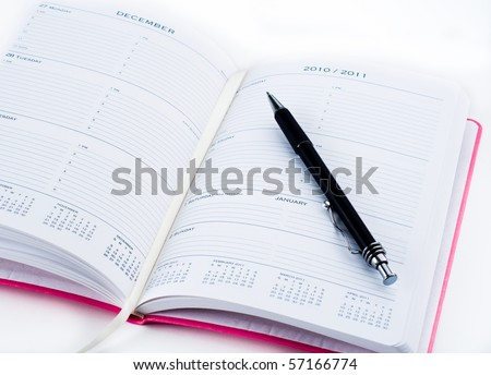 Pink Planner Opened on Page of Changing Years