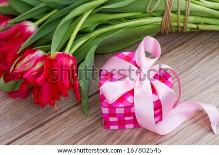 pink present box for valentines day with flowers
