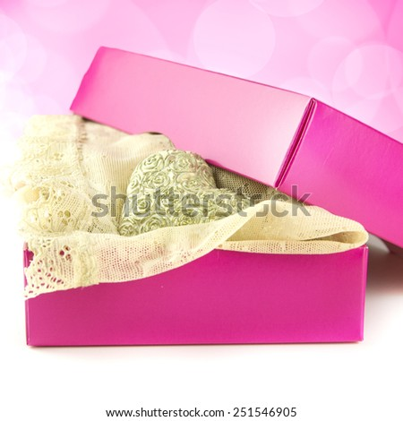 pink present for her with lacy lingerie and rose heart on the soft pink background