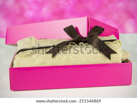 pink present with nice vintage lingerie for her on the pink background