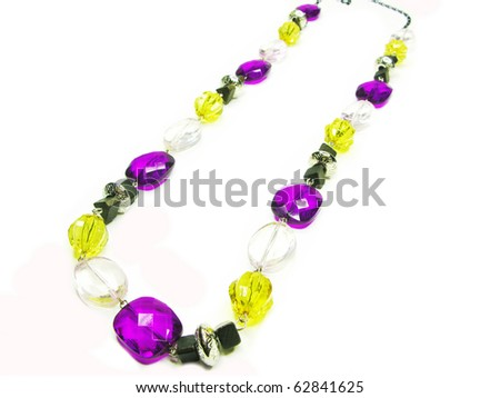 pink purple colored beads isolated on white background