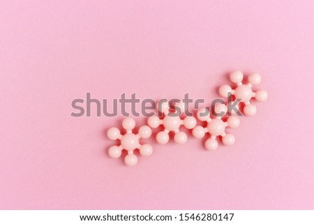 Pink Puzzle in form molecules, chain of molecules us chemical formula. Scientific approach and new methods in human life.