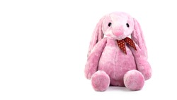 Pink rabbit doll with big ears isolated on white background. Cute stuffed animal and fluffy fur for kids.