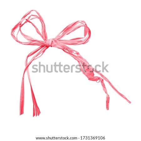 Pink raffia bow isolated on white Photo stock ©