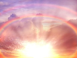 pink rainbow at dramatic sunset blue fluffy clouds ,bright sunbeam , cloudy sky nature landscape background weather forecast