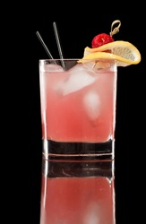 pink raspberry lemonade isolated on a black background garnished with lemon and red raspberry