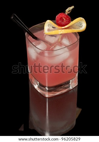 pink raspberry lemonade isolated on a black background garnished with lemon and red raspberry view from the top