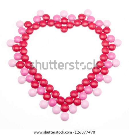 Pink, red and white chocolate covered candy shaped in a Heart for Valentines Day