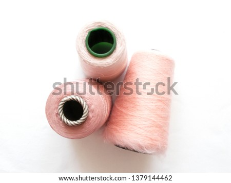 pink reels of yarn for knitting. cotton. mohair.  polyester
